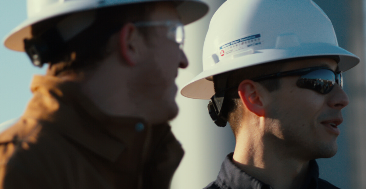 closeup of two men in hard hats